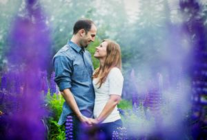 Engagement photos among lupines in Minnesota