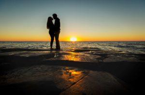 Engagement photos along Lake Superior at sunrise