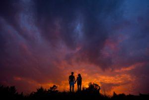 Engagement photos at sunset along Lake Superior